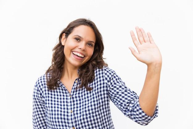 こんにちは手を振って幸せな甘い女 無料写真