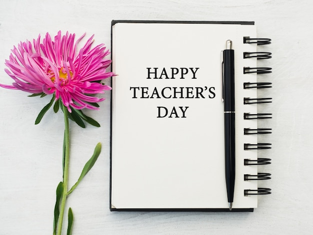 Happy teacher's day. beautiful greeting card. close-up, view from above. national holiday concept. congratulations for family, relatives, friends and colleagues Premium Photo