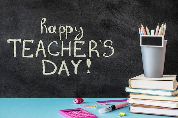 Happy teacher's day written on chalkboard Premium Photo