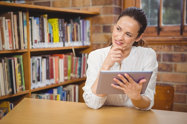 Happy teacher using her tablet pc Premium Photo