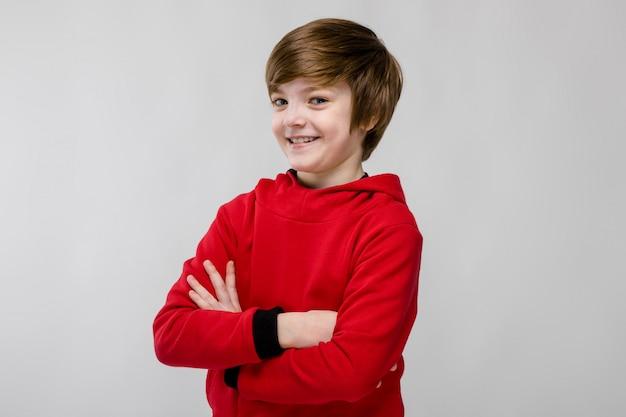 Happy teenage boy in fashionable clothes Premium Photo