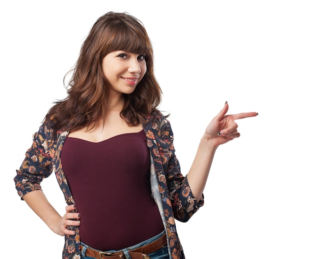 Happy teenager with fringe pointing Free Photo