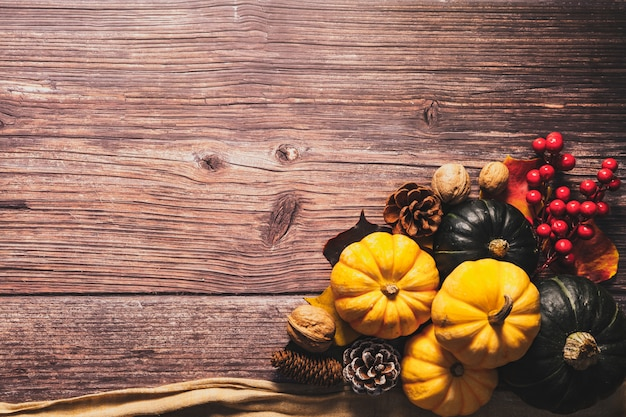 Happy thanksgiving day with pumpkin and nut on wooden table Premium Photo