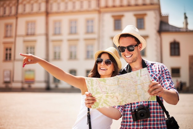 Happy tourist sightseeing city with map Free Photo