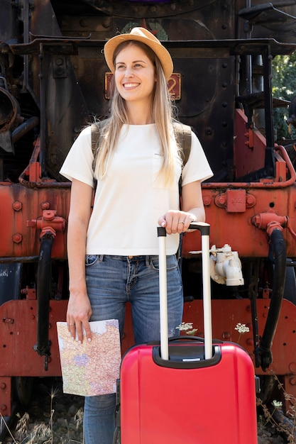 Happy traveller smiling at the train station Free Photo