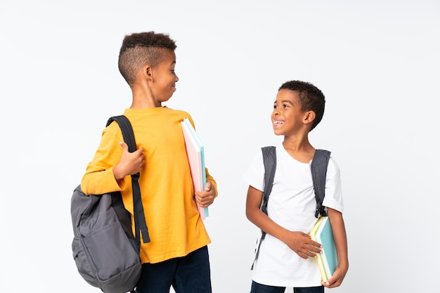 Happy two boys african american students over isolated white Premium Photo