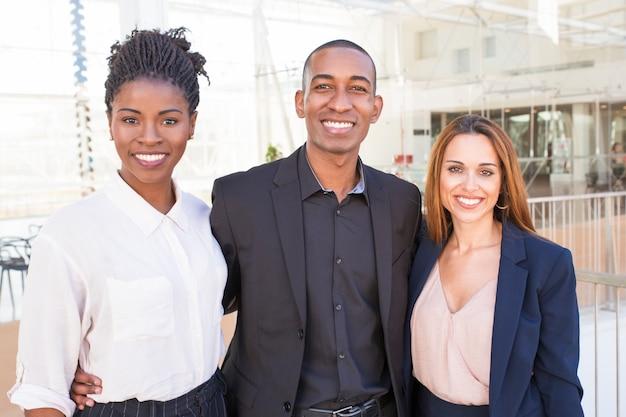 Happy united multiethnic team posing in office hall Free Photo