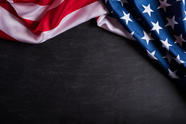 Happy veterans day. american flags against a blackboard background. Premium Photo