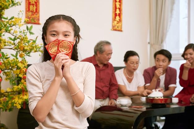 Happy vietnamese girl holding envelopes with Free Photo