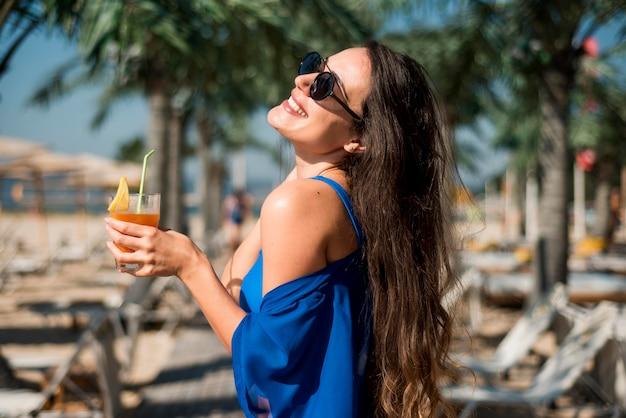 Happy woman at beach Free Photo