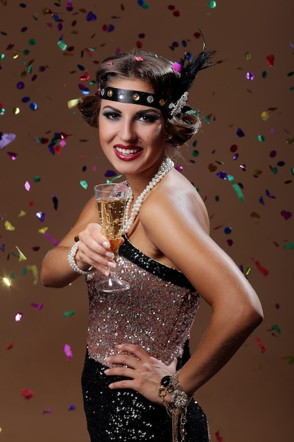 Happy woman cheers with confetti background Free Photo