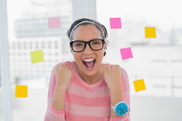 Happy woman in creative office Premium Photo