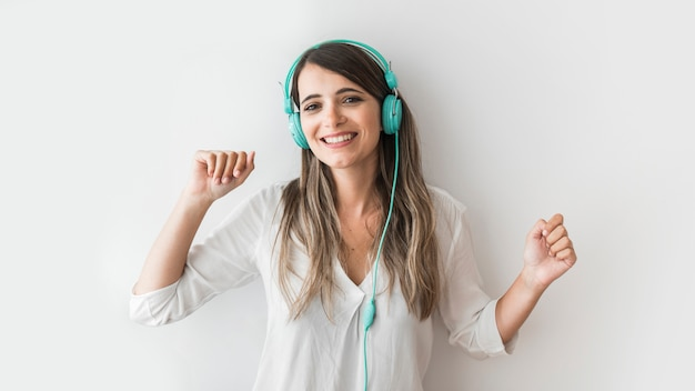Happy woman dancing with earphones Free Photo