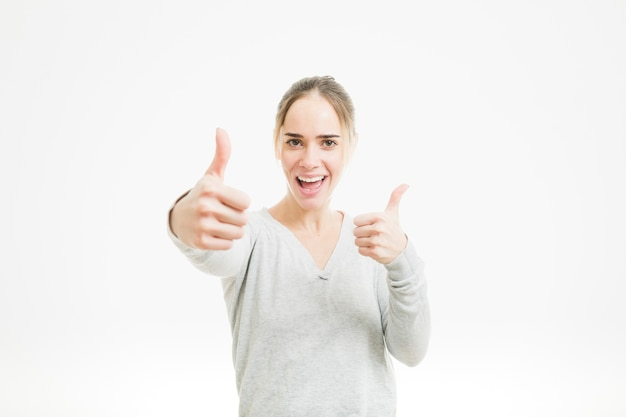 Happy woman doing thumbs up gesture Free Photo