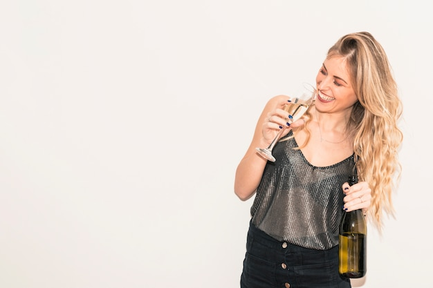 Happy woman drinking champagne from glass Free Photo