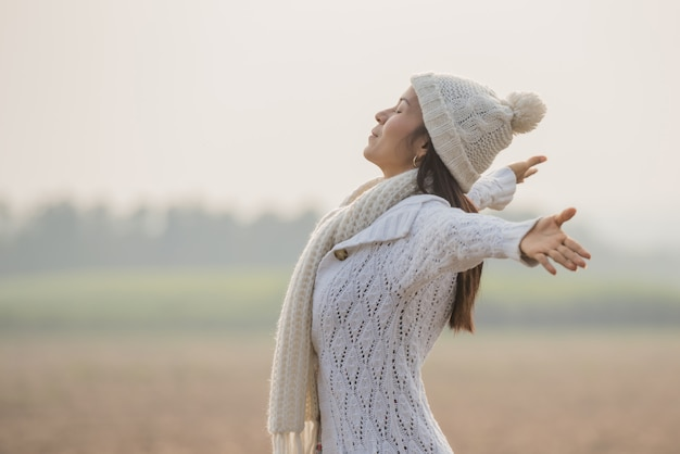 Happy woman enjoying in idyllic nature, celebrating freedom and rising her arms Free Photo