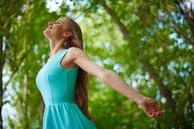 Happy woman enjoying nature Free Photo