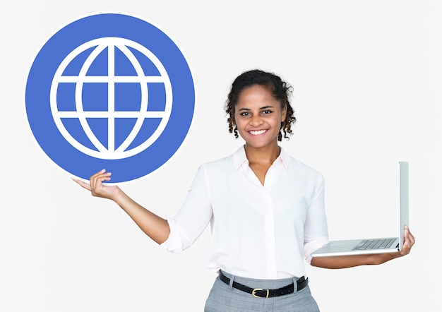 Happy woman holding a laptop and www icon Free Photo