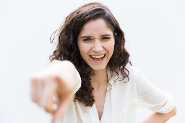Happy woman or intern pointing index finger Free Photo