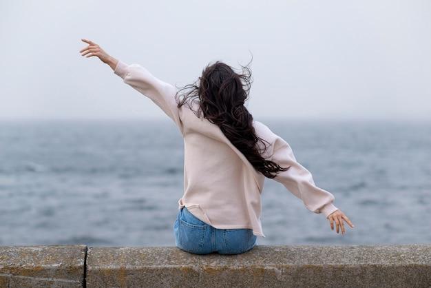 Happy woman at seaside Free Photo