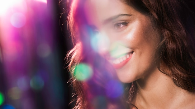 Happy woman smiling and blurred sparkles effect Premium Photo