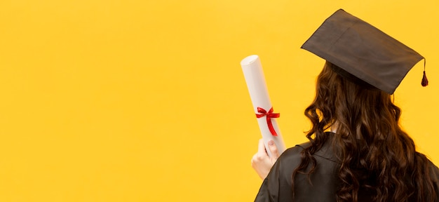 Happy woman with certificate back view Premium Photo