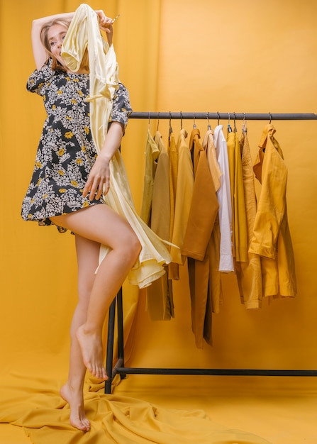Happy woman with dress in yellow scene Free Photo