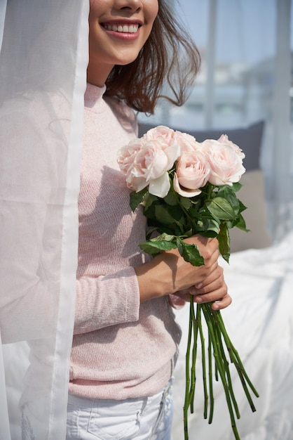 Happy woman with flowers Free Photo