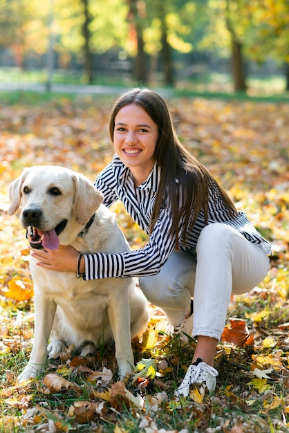 Happy woman with her cute dog Free Photo