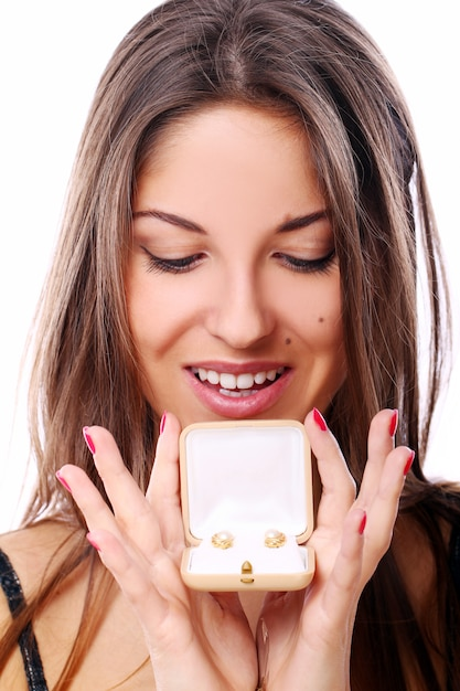 Happy woman with jewels in box Free Photo