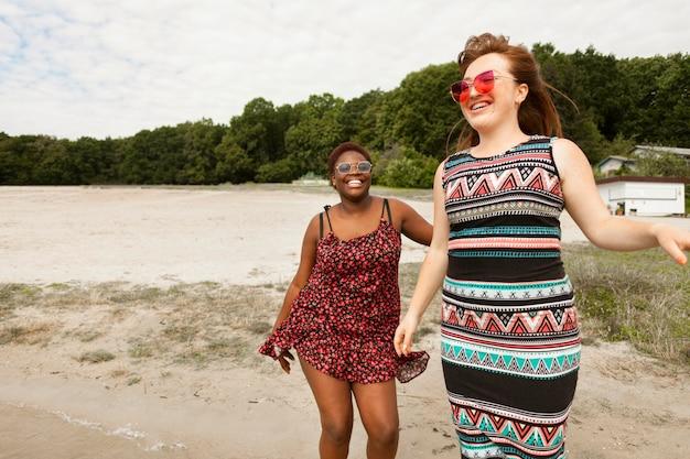 Happy women enjoying their time at the beach Free Photo