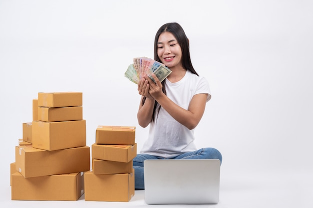 Happy women from ordering products from customers, business owners who work at home on a white backg Free Photo