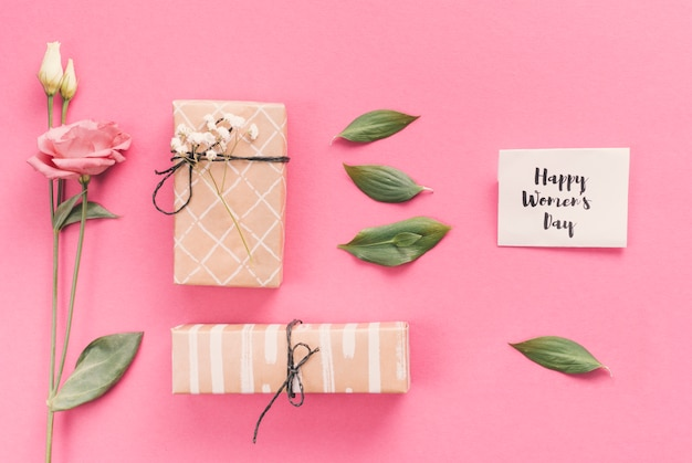 Happy womens day inscription with gifts and flowers Free Photo