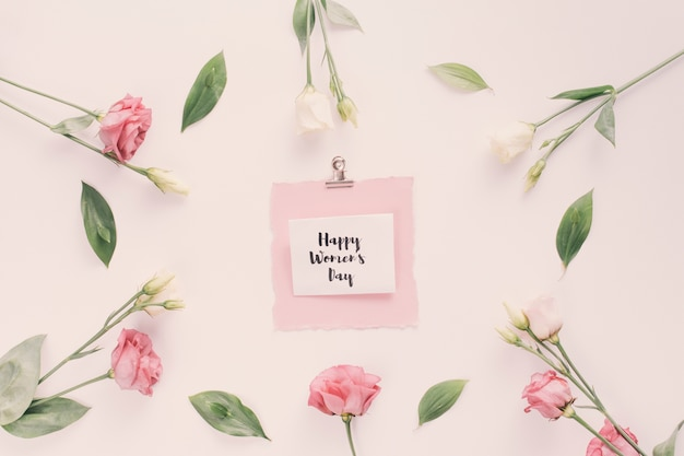 Happy womens day inscription with rose flowers Free Photo