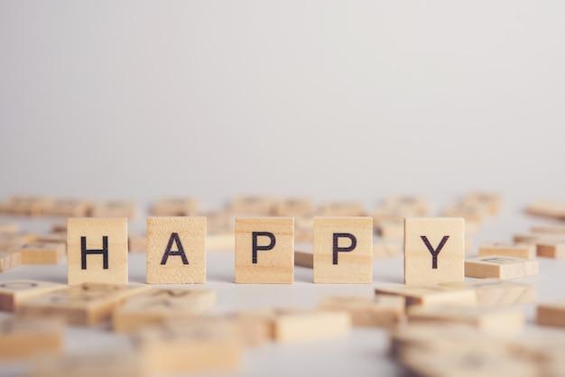 Happy wooden tile font concept Free Photo