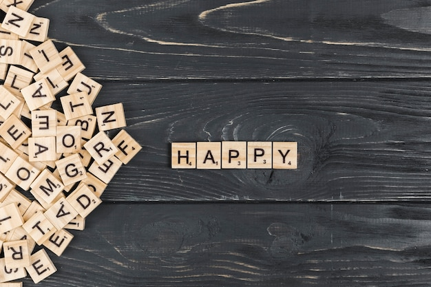 Happy word on wooden background Free Photo
