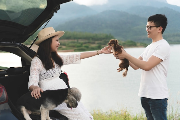 Happy and young asian couple enjoying life travel lifestyle with pets. Premium Photo