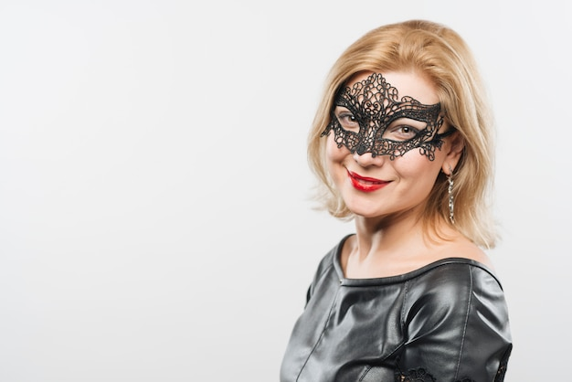 Happy young blond lady in mask Free Photo