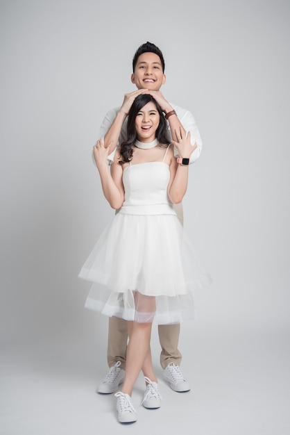 Premium Photo Happy Young Couple Asian Groom Embracing His Bride In Casual Wedding Dress,African American Black Woman Wedding Dress
