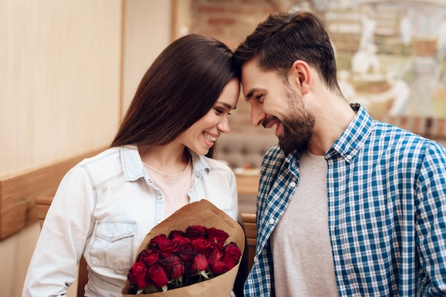 Happy young couple have date in modern cafeteria. Premium Photo