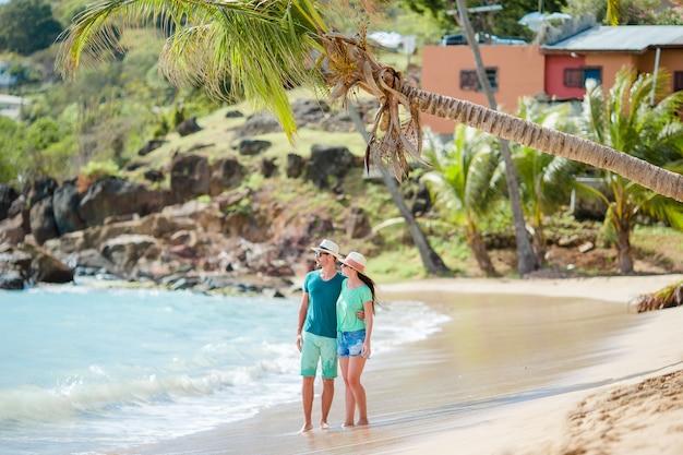 Happy young couple in honeymoon on the beach enjoy romatic vacation Premium Photo