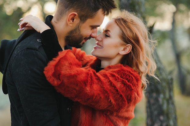 Happy young couple in love outdoor in autumn Premium Photo