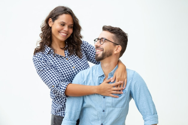 Happy young couple smiling each other Free Photo