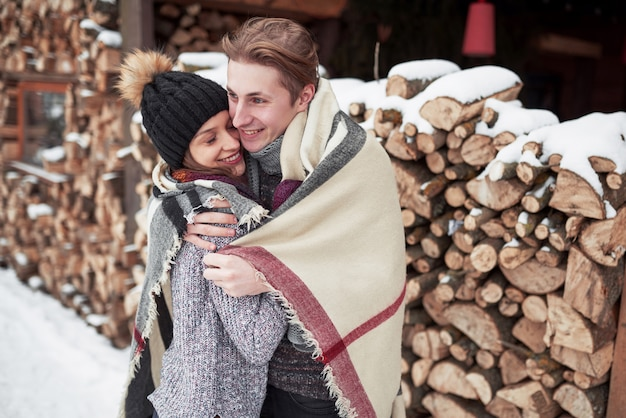 Happy young couple in winter park having fun.family outdoors. Premium Photo
