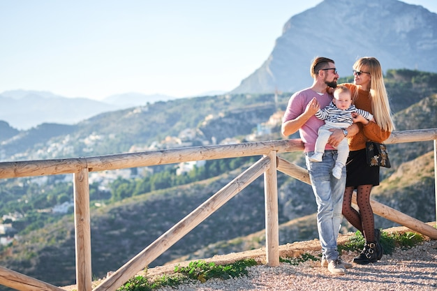 Happy young family with little cute boy enjoying the sunny day Premium Photo