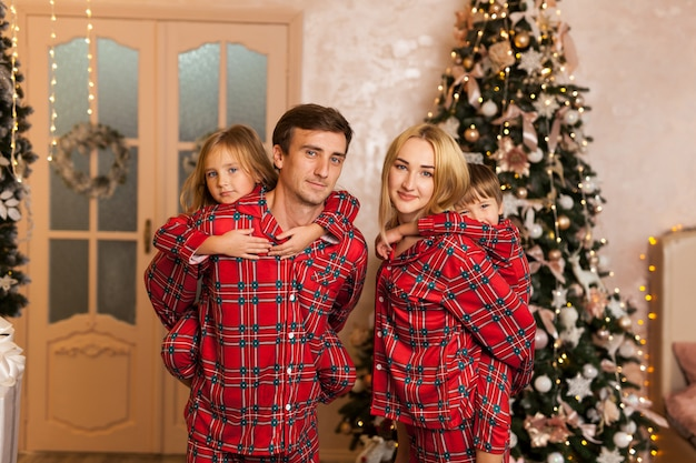 Happy young family with two children smiling Premium Photo