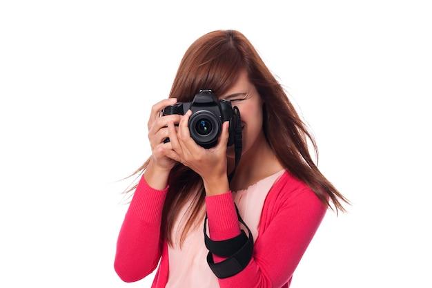 カメラと幸せな若い女性写真家 無料写真