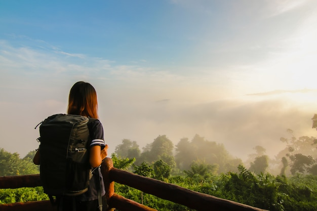 Happy young girl enjoy backpacking. refreshed and energize your life. Premium Photo