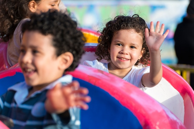 Happy young girl having fun at amusement park Premium Photo