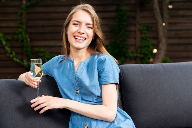 Happy young girl holding a champagne glass Free Photo